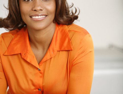 Colorful-portrait-of-smiling-woman-in-orange-top