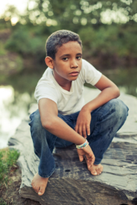 Outdoor portrait of a boy by Pierre Arsenault, photographer in Montreal